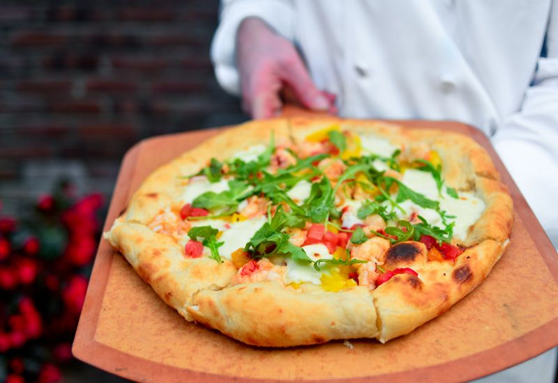 chef prepared pizza at the greenbrier resort