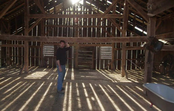 mark bowe standing in a barn