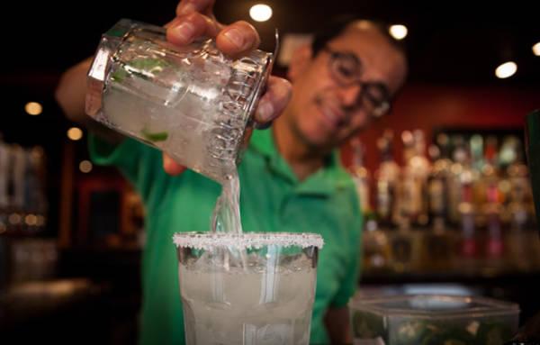 Gentleman pouring margarita