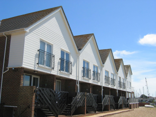 Coastal flats with maintenance-free windows, doors, and cladding.