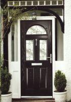 Glass-panelled black composite door