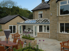 Wide T-Shape conservatory with bi-folding doors