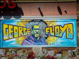 A mural stands in memoriam outside the Cup Foods convenience store in Minneapolis near where George Floyd was murdered by police May 25, 2020. The area is now known as George Floyd Square.