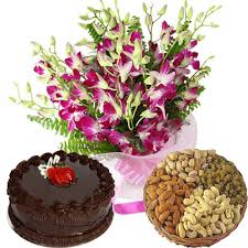 Dryfruits with cake and orchids