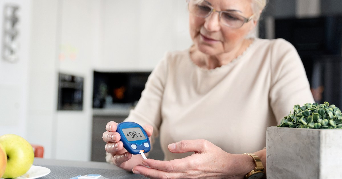 Woman checks her blood glucose as part of her sick day plan