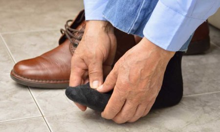 A man checks the health of his foot