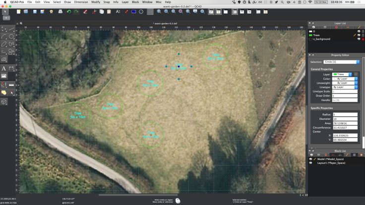 Screenshot of CAD program with large scale satellite photo in background and circles for trees