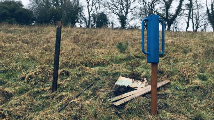 Dead hedge in process of being built, with blue hedge hammer