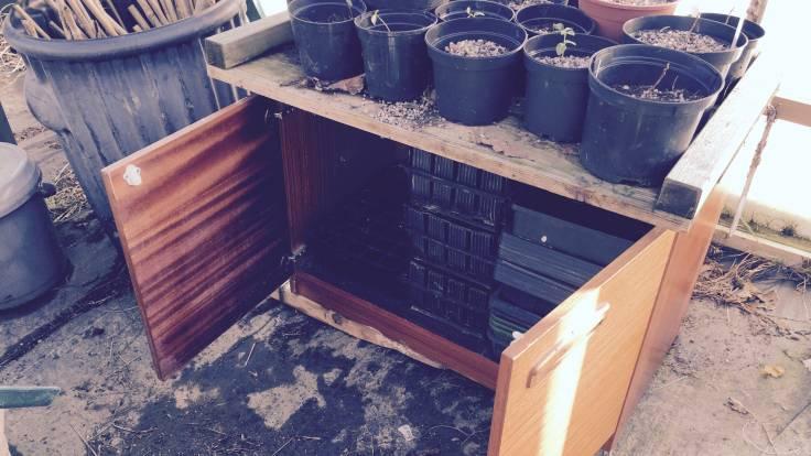 Old knackered cupboard with open doors