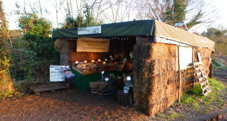 Shed for selling vegetables made of straw bales and canvas, photo copyright Tolhurst Organic