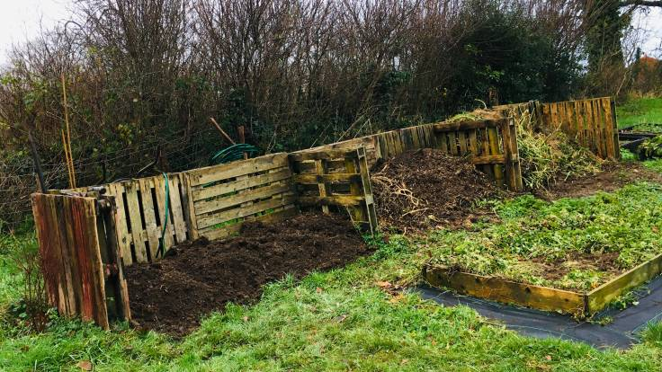 Three compost bays, all partly filled