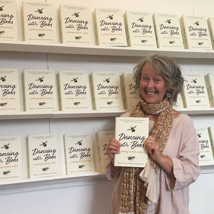 Photo of Brigit Strawbridge Howard with her book 'Dancing With Bees'