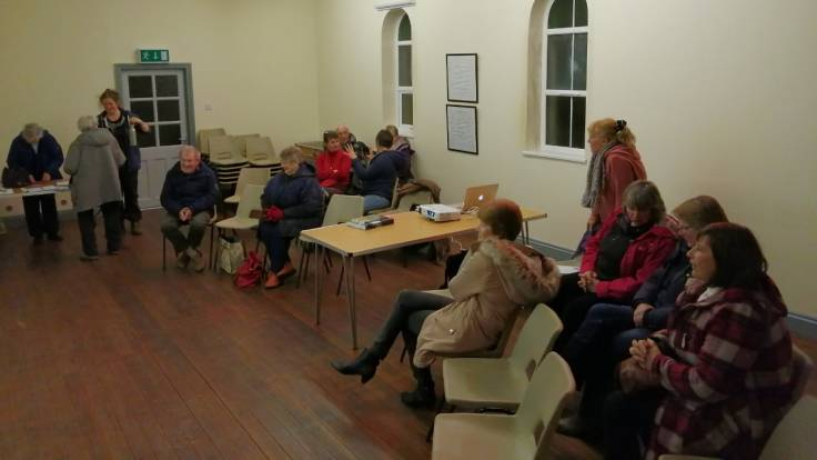 A dozen people in a small church hall