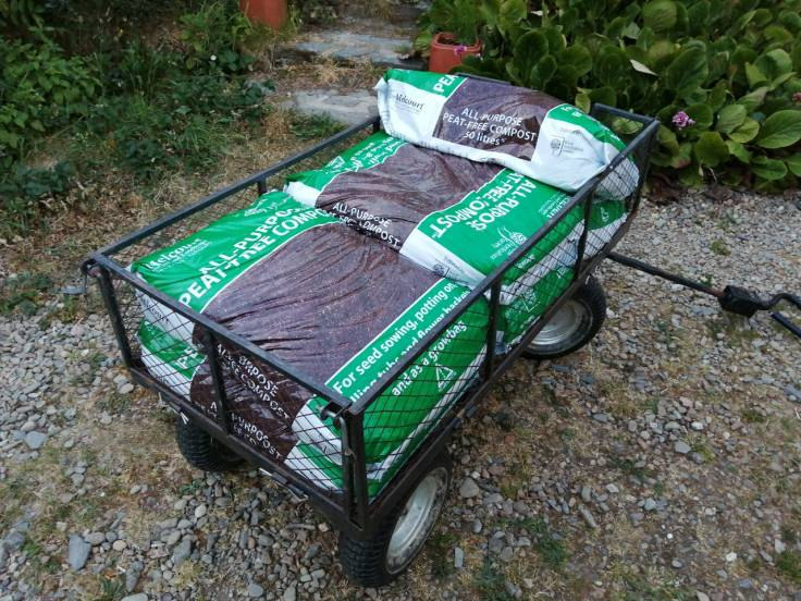 Cart with bags of compost