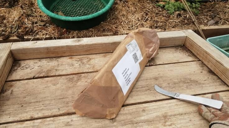 Toblerone shaped parcel next to garden knife