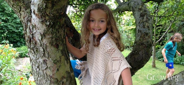 Girl climbing a tree