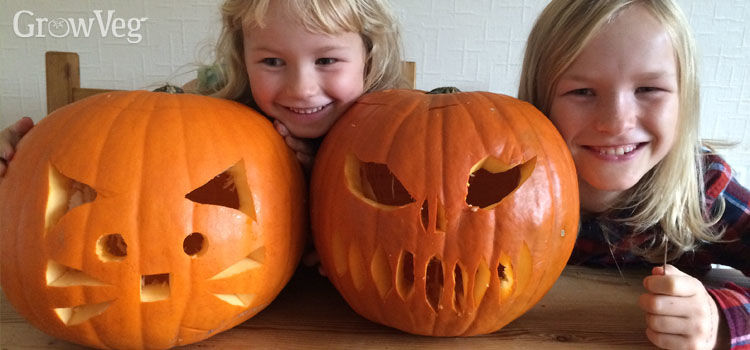 Kids with carved jack-o-lanterns