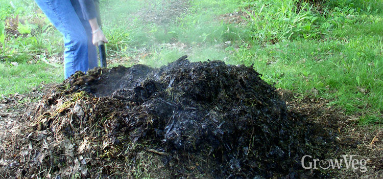 Turning a hot compost pile