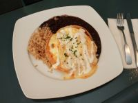 Two Eggs Over Easy, Crispy Corn Tortillas, Salsa De Chili De Arbol, Cheddar  Cheese And Crema Fresca. Served With Organic Brown Rice And Beans. Gluten  Free.