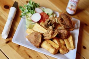 Yuca con Chicharron - delivery menu