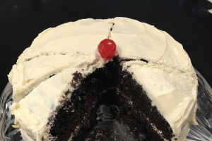 Double Chocolate Bundt Cake w/ White Frosting -- Slice - delivery menu
