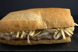 Bistec Encebollado Sandwich - delivery menu