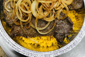 Bistec con Cebollas - delivery menu