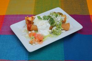 2 Taquitos Rancheros - delivery menu