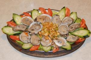 1 Docena de Ostiones en su Concha - delivery menu