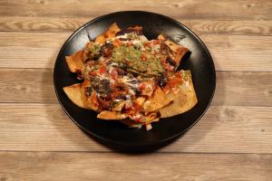 De la Casa Nachos - delivery menu