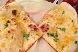 67. Garlic Naan - delivery menu