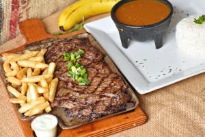 Carne Asada con 3 acompanantes - delivery menu