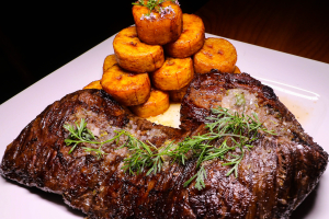 Grilled Churrasco w/ Tostones  - delivery menu