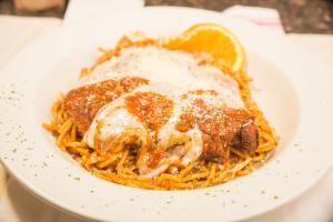 Chicken Parmigiana over Spaghetti - delivery menu