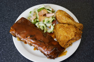 1/2 Rack Baby Back Ribs and 2 Pieces of Broasted Chicken - delivery menu