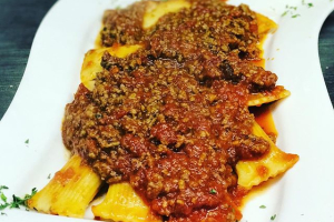 Stuffed Rigatoni topped with Meatsauce - delivery menu