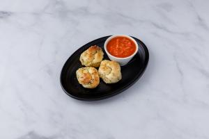 4 Pieces Garlic Knots - delivery menu