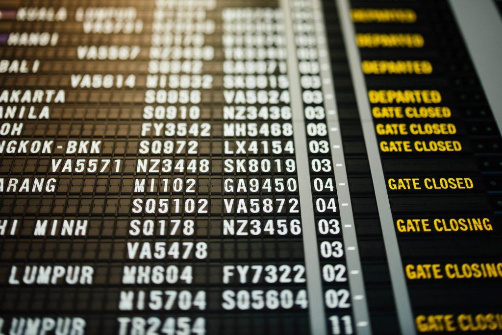 an ariport information board showing flight information