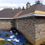 Homeowner receiving new roof due to hail storm