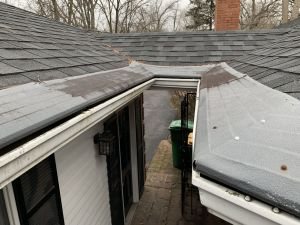 gutter helmet screwed to shingles