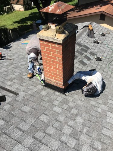 roofers counter flashing a square brick chimney