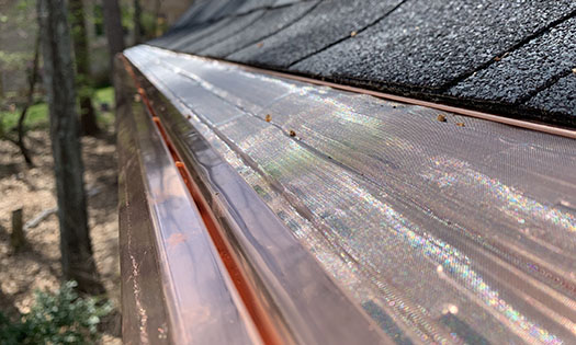 Mastershield copper gutter guard installed on a home in Knoxville Tennessee