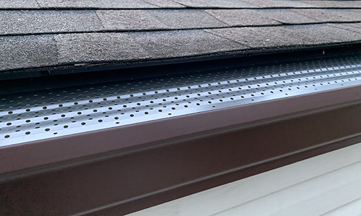 gutter rx gutter guard in dark bronze installed on a 6 inch gutter