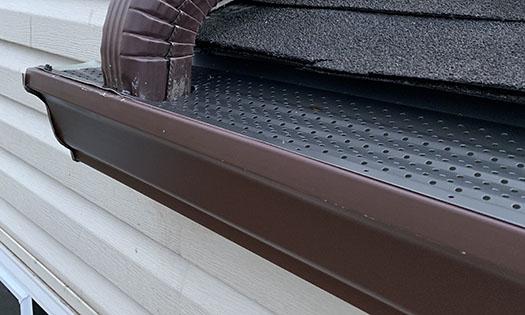 gutter rx dark bronze gutter guards installed on 6 inch brown gutters