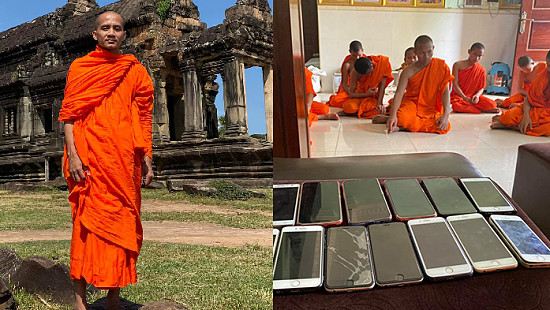 A%20monk%20in%20Kratie%20picks%20up%20a%20phone%20for...