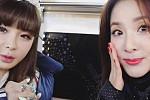 Park Bom and Sandara shake hands with...