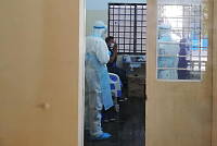 A Khmer man infected with COVID-19...