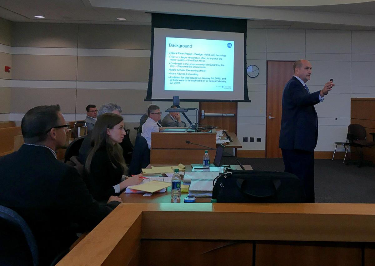 Attorney Rob Remington, standing at right, makes his opening statement on behalf of Mark Schaffer Excavating & Trucking Inc. in a hearing for the company's lawsuit against the City of Lorain. Richard Payerchin  -- The Morning Journal