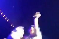 Lady Gaga falls behind on stage and...