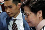 Hong Kong lawmakers force Carrie Lam...